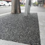 the-entrance-tree-pits-charcoal-rubber-glass